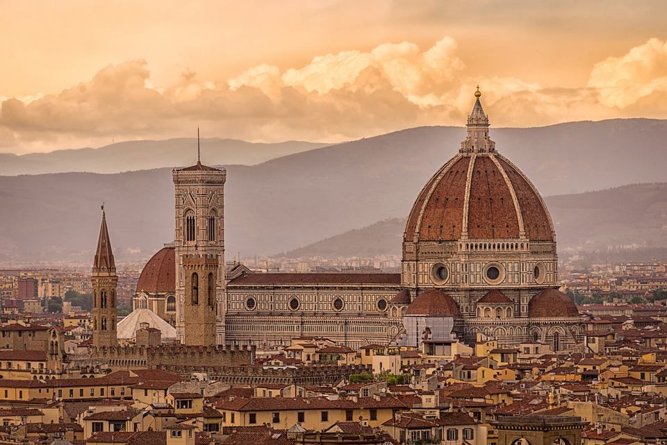 A landscape of Florence, Italy featuring architectural buildings including cathedrals and steeples.
