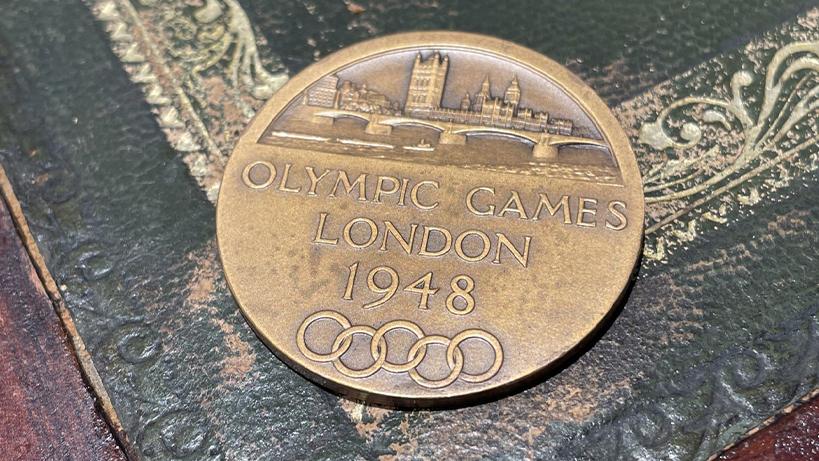 Prototype bronze participation medal.