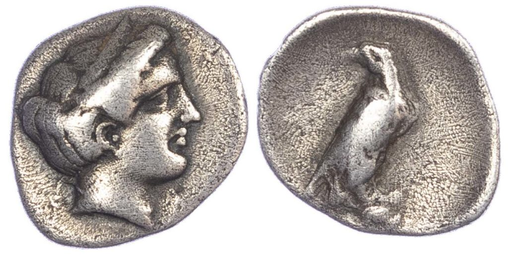 Silver Hemidrachm coin. Obverse: Head of Hera facing right, wearing stephane. Reverse: Eagle standing right on rock, wings closed and head left.