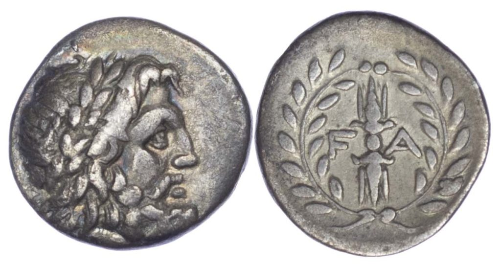 A silver Hemidrachm from Olympia featuring Laureate head of Zeus facing right on obverse and F-A, Thunderbolt, all within an olive wreath on reverse.