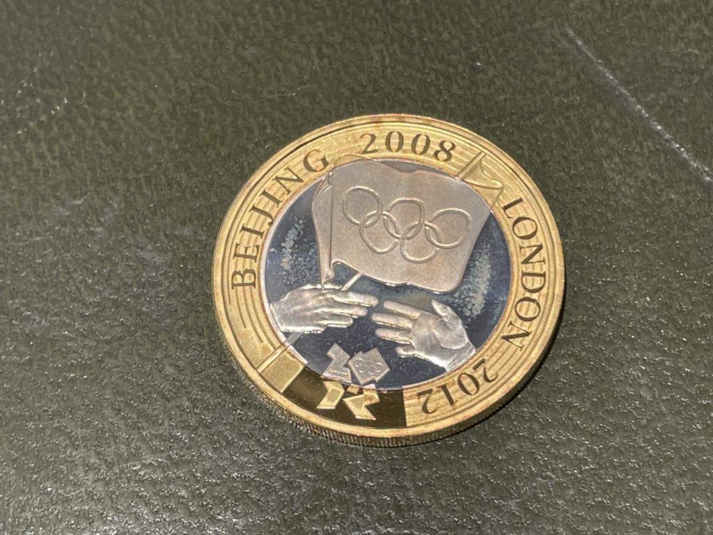 The Royal Mint's 2008 Two Pound Coin. The reverse features the symbolic handover of the Olympic Games from China to Britain. This is the Proof Silver strike.